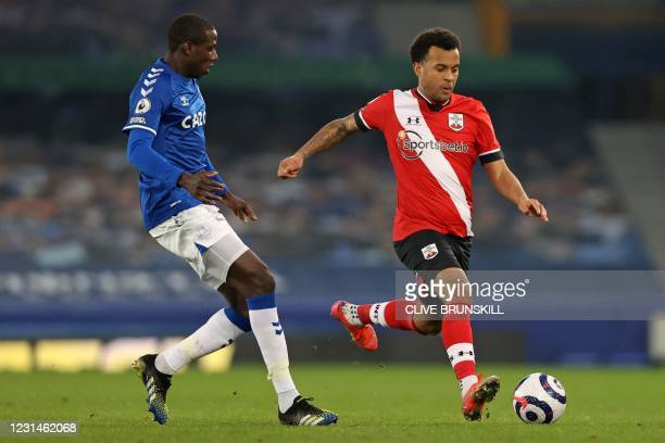 Everton's French midfielder Abdoulaye Doucoure vies with Southampton's English defender Ryan Bertrand during the English Premier League football...