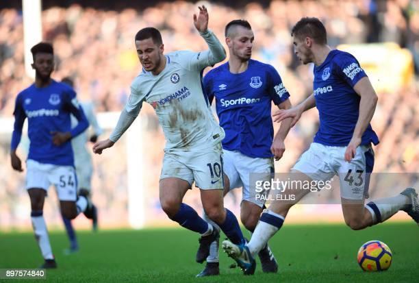 Everton's French midfielder Morgan Schneiderlin fouls Chelsea's Belgian midfielder Eden Hazard during the English Premier League football match...