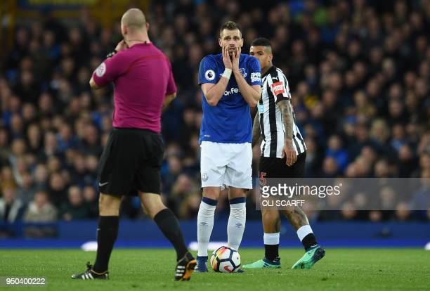 Everton's French midfielder Morgan Schneiderlin reacts as English referee Bobby Madley awards a freekick to Newcastle during the English Premier...