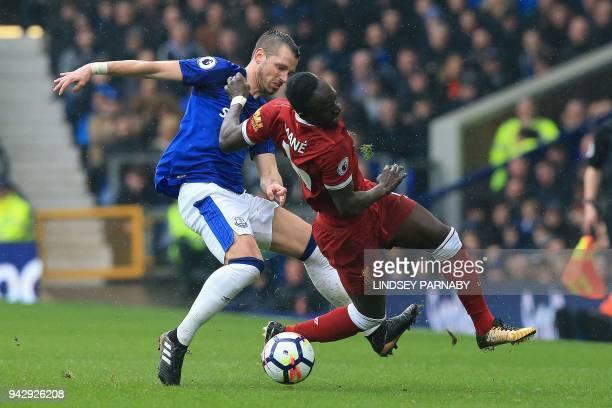 Everton's French midfielder Morgan Schneiderlin tackles Liverpool's Senegalese midfielder Sadio Mane during the English Premier League football match...