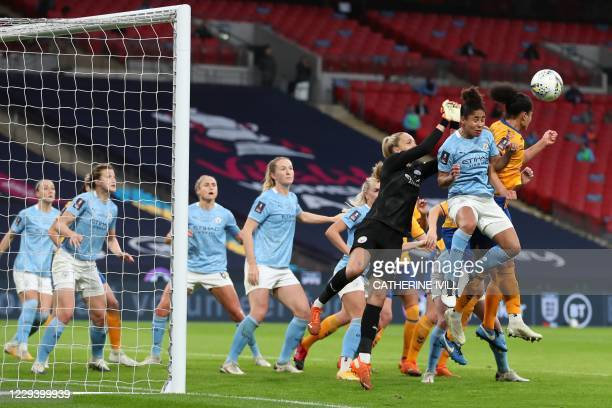 Everton's French striker Valerie Gauvin jumps to head the ball to score the equalising goal during the English Women's FA Cup final football match...