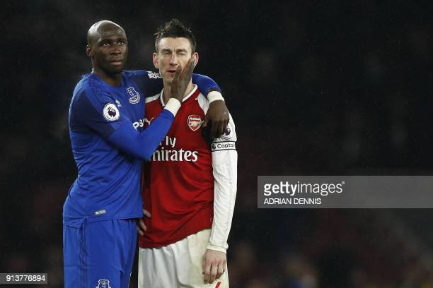 Everton's French striker Yannick Bolasie and Arsenal's French defender Laurent Koscielny gesture at the final whistle during the English Premier...