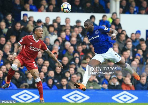 Everton's French striker Yannick Bolasie and Liverpool's English defender Nathaniel Clyne go for a high ball during the English Premier League...