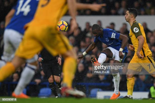 Everton's French striker Yannick Bolasie crosses the ball to Everton's English striker Theo Walcott during the English Premier League football match...
