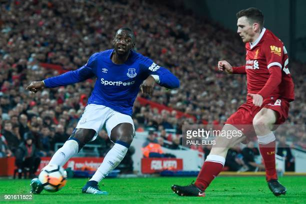 Everton's French striker Yannick Bolasie plays the ball as Liverpool's Scottish defender Andrew Robertson defends during the English FA Cup third...