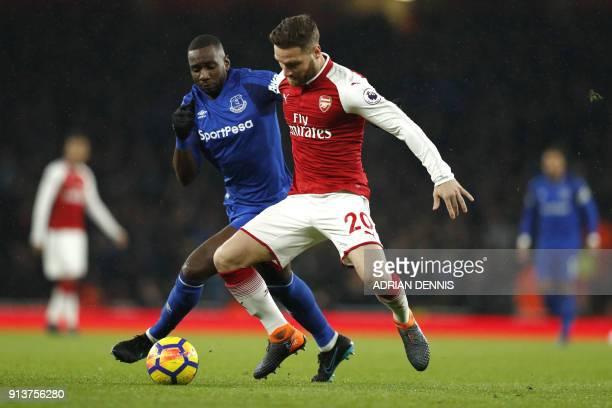 Everton's French striker Yannick Bolasie vies with Arsenal's German defender Shkodran Mustafi during the English Premier League football match...