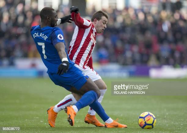 Everton's French striker Yannick Bolasie vies with Stoke City's Swiss forward Xherdan Shaqiri during the English Premier League football match...
