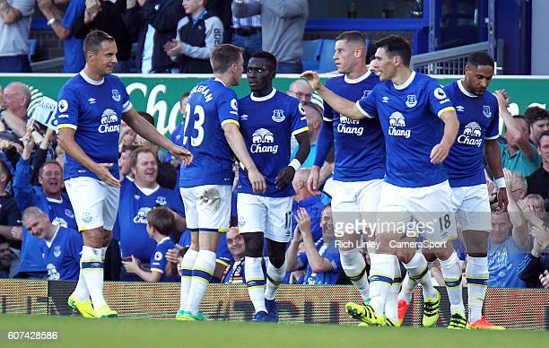 Everton's Gareth Barry is congratulated by team mates after scoring his sides equalising goal to make the score 1 1 during the Premier League match...