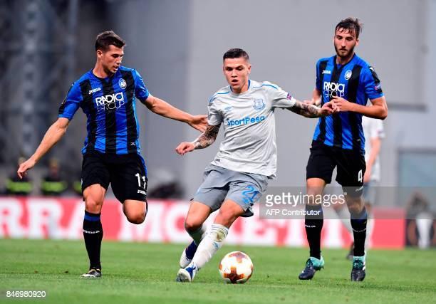 Everton's German midfielder Muhamed Besic vies with Atalanta's Swiss midfielder Remo Freuler and Atalanta's Italian midfielder Brian Cristante during...