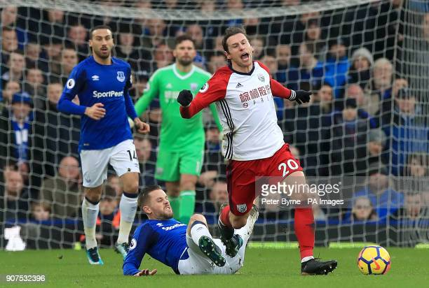 Everton's Gylfi Sigurdsson challenges West Bromwich Albion's Grzegorz Krychowiak during the Premier League match at Goodison Park Liverpool