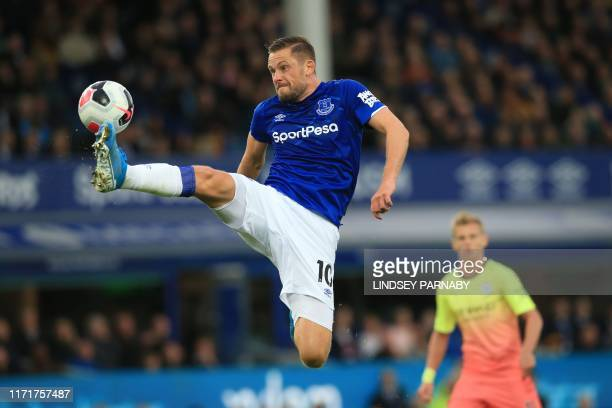 Everton's Icelandic midfielder Gylfi Sigurdsson controls the ball during the English Premier League football match between Everton and Manchester...