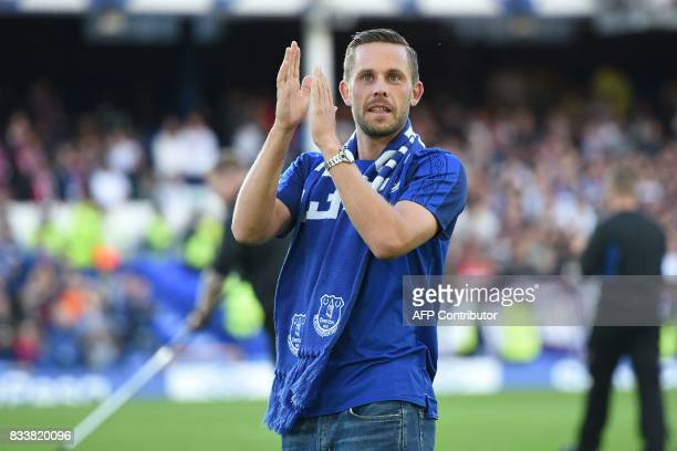 Everton's Icelandic midfielder Gylfi Sigurdsson is introduced to supporters on the pitch ahead of the UEFA Europa League playoff round first leg...