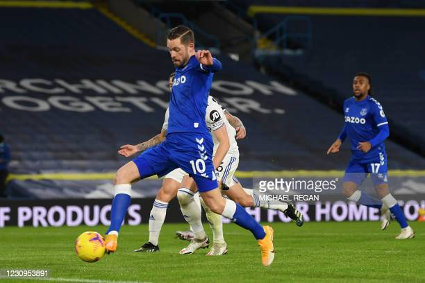 Everton's Icelandic midfielder Gylfi Sigurdsson scores the opening goal of the English Premier League football match between Leeds United and Everton...