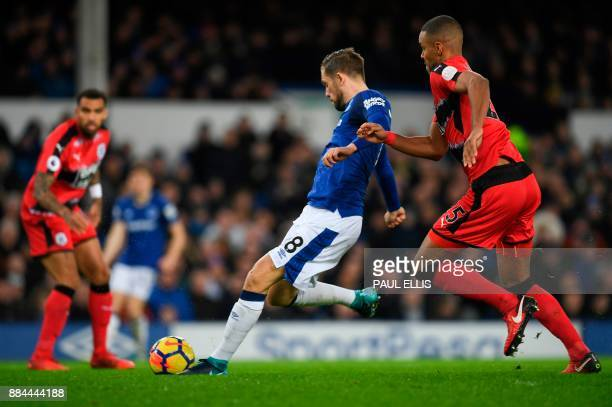 Everton's Icelandic midfielder Gylfi Sigurdsson scores the opening goal during the English Premier League football match between Everton and...