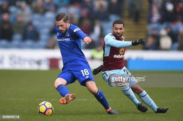 Everton's Icelandic midfielder Gylfi Sigurdsson vies with Burnley's English midfielder Aaron Lennon during the English Premier League football match...
