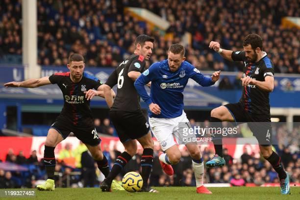 Everton's Icelandic midfielder Gylfi Sigurdsson vies with Crystal Palace's English defender Gary Cahill , Crystal Palace's English defender Scott...