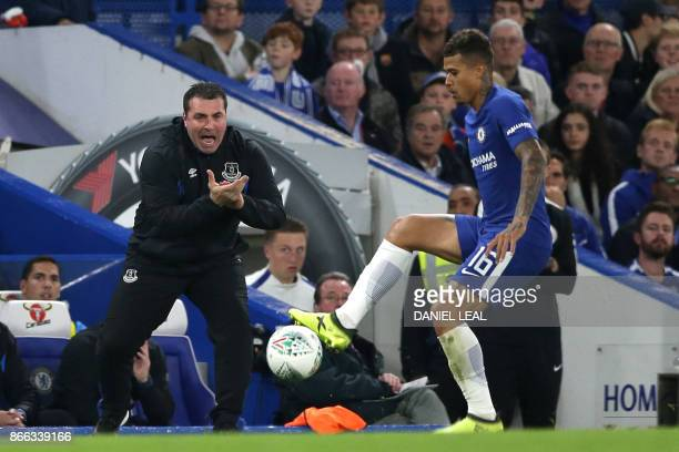 Everton's interim manager David Unsworth cheers on his team during the English League Cup fourth round football match between Chelsea and Everton at...