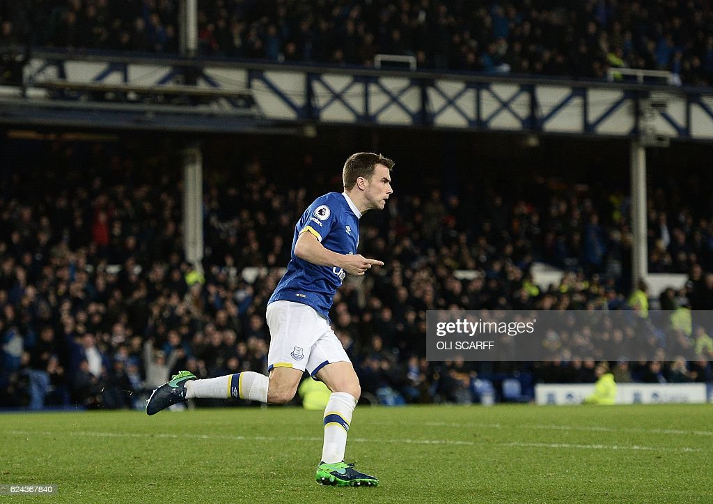 Everton's Irish defender Seamus Coleman celebrates scoring his team's first goal during the English Premier League football match between Everton and Swansea City at Goodison Park in Liverpool, north west England on November 19, 2016. / AFP / Oli SCARFF / RESTRICTED TO EDITORIAL USE. No use with unauthorized audio, video, data, fixture lists, club/league logos or 'live' services. Online in-match use limited to 75 images, no video emulation. No use in betting, games or single club/league/player publications. /