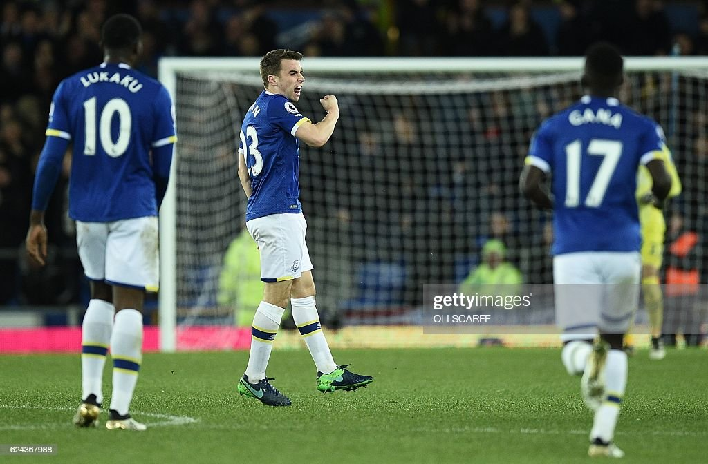 Everton's Irish defender Seamus Coleman (C) celebrates scoring his team's first goal during the English Premier League football match between Everton and Swansea City at Goodison Park in Liverpool, north west England on November 19, 2016. / AFP / Oli SCARFF / RESTRICTED TO EDITORIAL USE. No use with unauthorized audio, video, data, fixture lists, club/league logos or 'live' services. Online in-match use limited to 75 images, no video emulation. No use in betting, games or single club/league/player publications. /