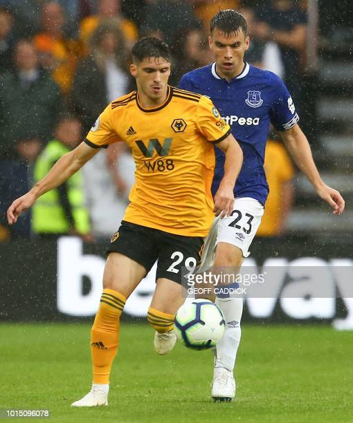 Everton's Irish defender Seamus Coleman challenges Wolverhampton Wanderers' Portuguese defender Ruben Vinagre during the English Premier League...