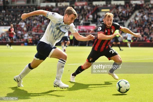 Everton's Irish defender Seamus Coleman chases the ball under pressure from Bournemouth's Scottish midfielder Ryan Fraser during the English Premier...