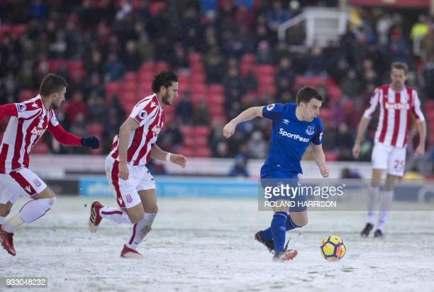 Everton's Irish defender Seamus Coleman controls the ball with Stoke City's Egyptian midfielder Ramadan Sobhi follows during the English Premier...