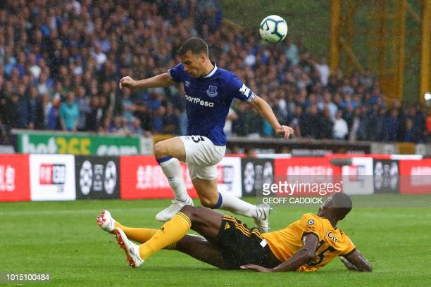 Everton's Irish defender Seamus Coleman is tackled by Wolverhampton Wanderers' French defender Willy Boly during the English Premier League football...
