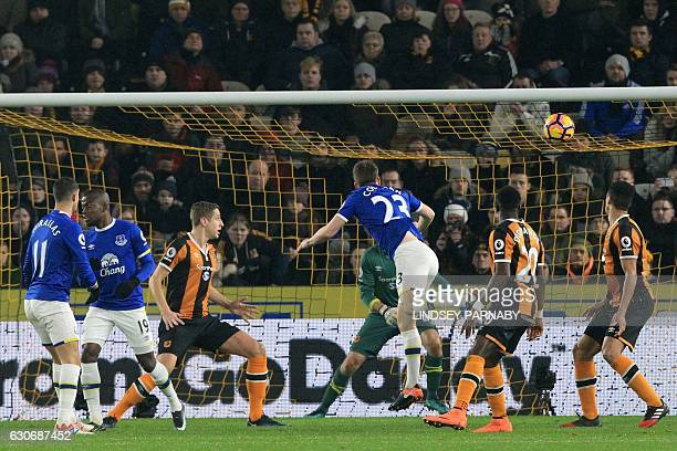 Everton's Irish defender Seamus Coleman sees his header hit the post during the English Premier League football match between Hull City and Everton...