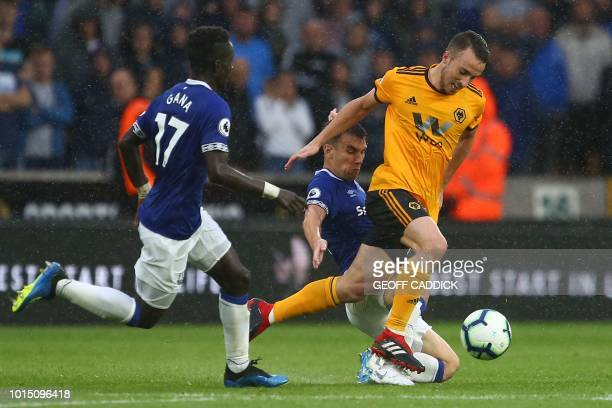Everton's Irish defender Seamus Coleman tackles Wolverhampton Wanderers' Portuguese midfielder Diogo Jota during the English Premier League football...
