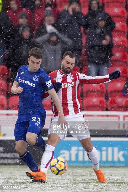 Everton's Irish defender Seamus Coleman vies with Stoke City's Spanish striker Jese during the English Premier League football match between Stoke...