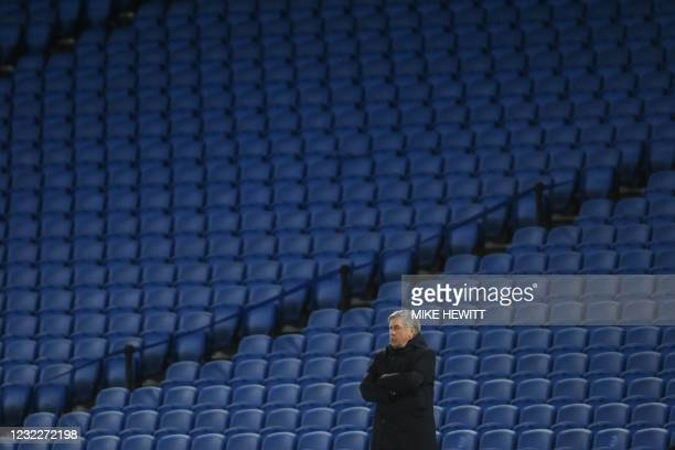 Everton's Italian head coach Carlo Ancelotti stands before an empty stand during the English Premier League football match between Brighton and Hove...