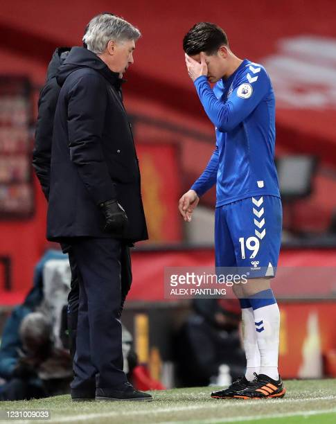 Everton's Italian head coach Carlo Ancelotti substitutes Everton's Colombian midfielder James Rodriguez during the English Premier League football...