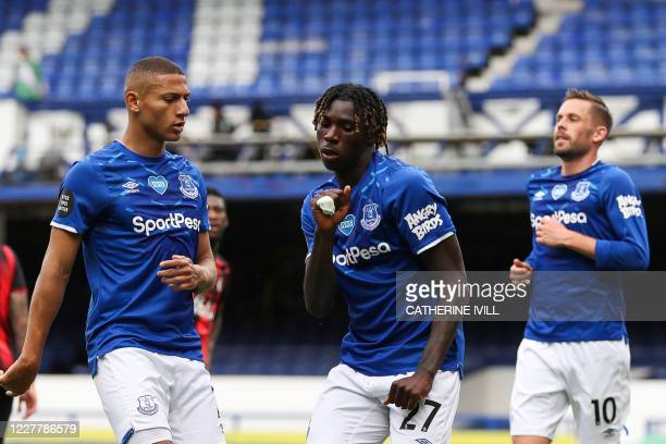 Everton's Italian midfielder Moise Kean celebrates with teammates after scoring a goal during the English Premier League football match between...