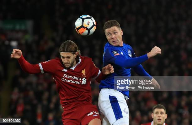 Everton's James McCarthy and Liverpool's Adam Lallana battle for the ball during the FA Cup third round match at Anfield Liverpool