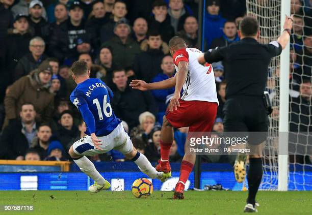 Everton's James McCarthy gets injured after attempting to block a shot from West Bromwich Albion's Salomon Rondon during the Premier League match at...