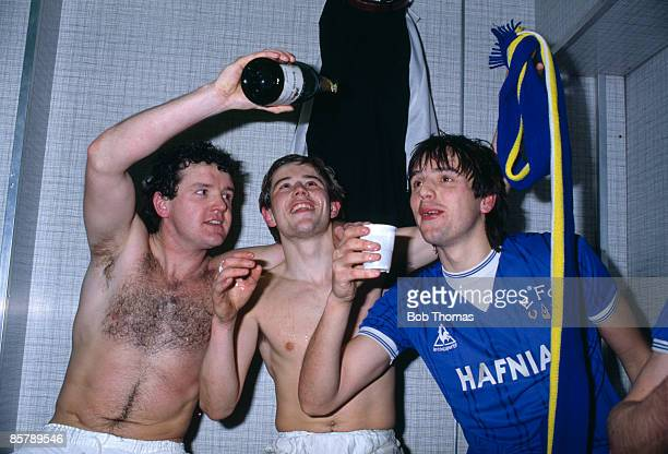 Everton's John Bailey pours the champagne for Graeme Sharp and Adrian Heath in the dressingroom at Villa Park after they had beaten Aston Villa 21 on...