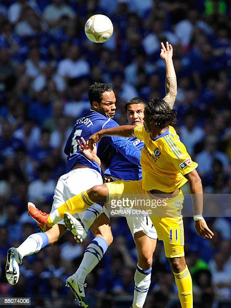 Everton's Joleon Lescott and Tim Cahill vie for the ball against Chelsea's Didier Drogba in the FA Cup final at Wembley in north Londonon May 30 2009...