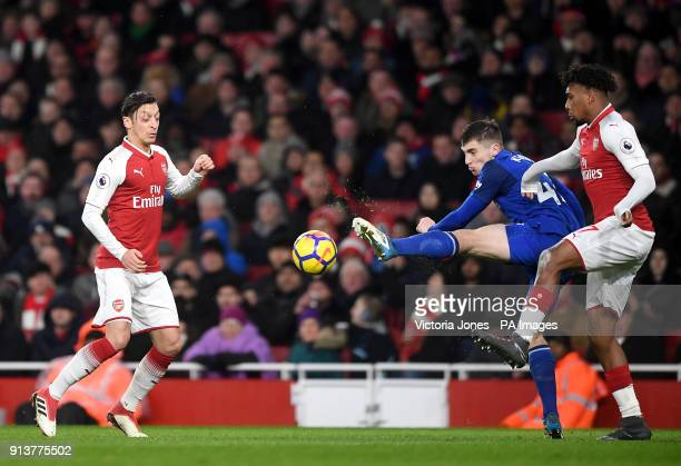 Everton's Jonjoe Kenny battles for the ball with Arsenal's Mesut Ozil and Alex Iwobi during the Premier League match at the Emirates Stadium London