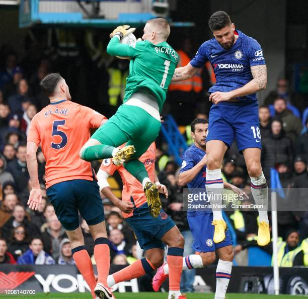Everton's Jordan Pickford makes a save despite the attentions of Olivier Giroud during the Premier League match between Chelsea FC and Everton FC at...