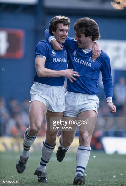 Everton's Kevin Sheedy is congratulated by team captain Kevin Ratcliffe after he had scored the first goal in their FA Cup 6th round tie against...