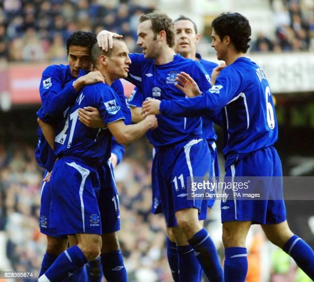 Everton's Leon Osman celebrates scoring against West Ham United with teammates during the Barclays Premiership match at Upton Park east London...
