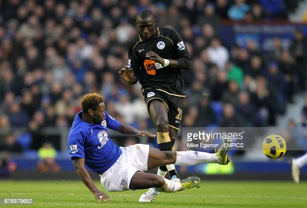 Everton's Louis Saha slides in to challenge Wigan Athletic's Mohamed Diame