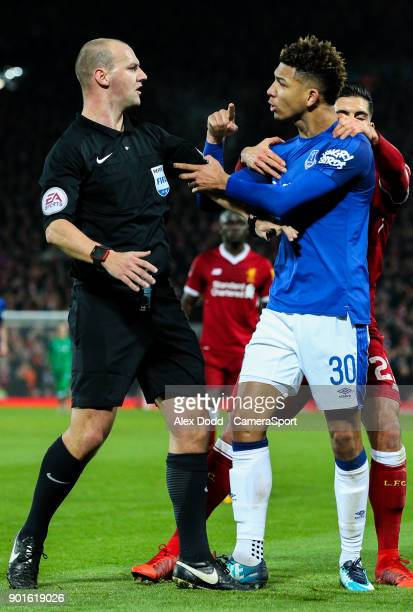 LIVERPOOL ENGLAND JANUARY Everton's Mason Holgate appears to manhandle referee Robert Madley over an altercation with Liverpool's Roberto Firmino...