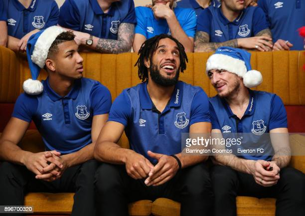 Everton's Mason Holgate Ashely Williams and Leighton Baines during their Christmas visit at Alder Hey Childrens Hospital on December 21 2017 in...