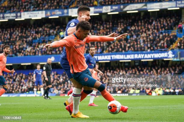 Everton's Mason Holgate holds off the challenge from Chelsea's Olivier Giroud during the Premier League match between Chelsea FC and Everton FC at...