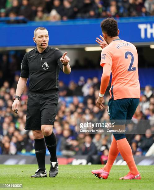 Everton's Mason Holgate questions Referee Kevin Friend decision to not give a yellow card during the Premier League match between Chelsea FC and...