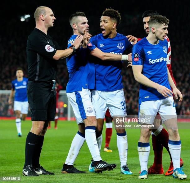 Everton's Mason Holgate shouts to referee Robert Madley over an altercation with Liverpool's Roberto Firmino during the Emirates FA Cup Third Round...
