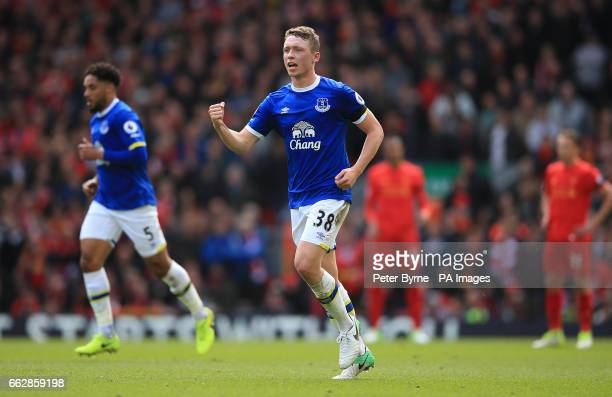 Everton's Matthew Pennington celebrates scoring his side's first goal during the Premier League match at Anfield Liverpool