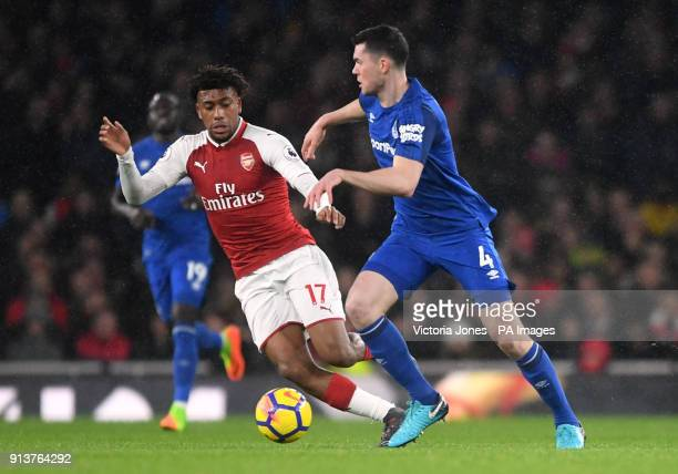 Everton's Michael Keane and Arsenal's Alex Iwobi battle for the ball during the Premier League match at the Emirates Stadium London
