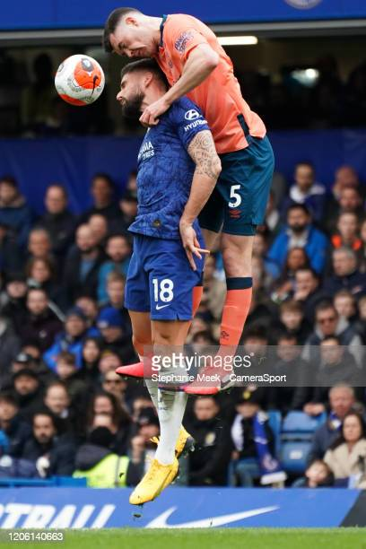 Everton's Michael Keane battles for possession with Chelsea's Olivier Giroud during the Premier League match between Chelsea FC and Everton FC at...